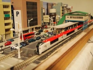train station with parking lot in Japan-themed railroad model