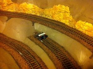 Brown ballast under the train tracks.